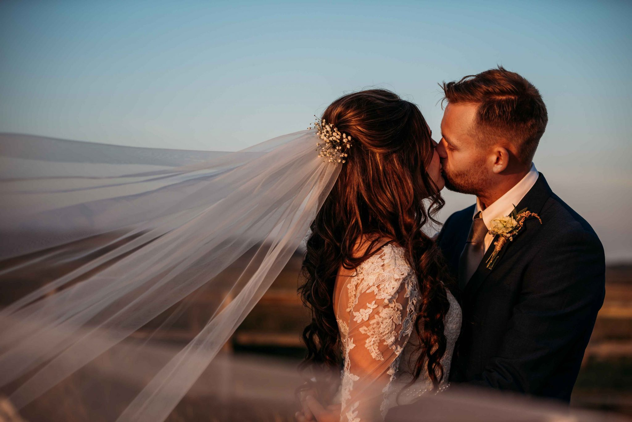 Wedding Couple Kissing with a Swooping Trail